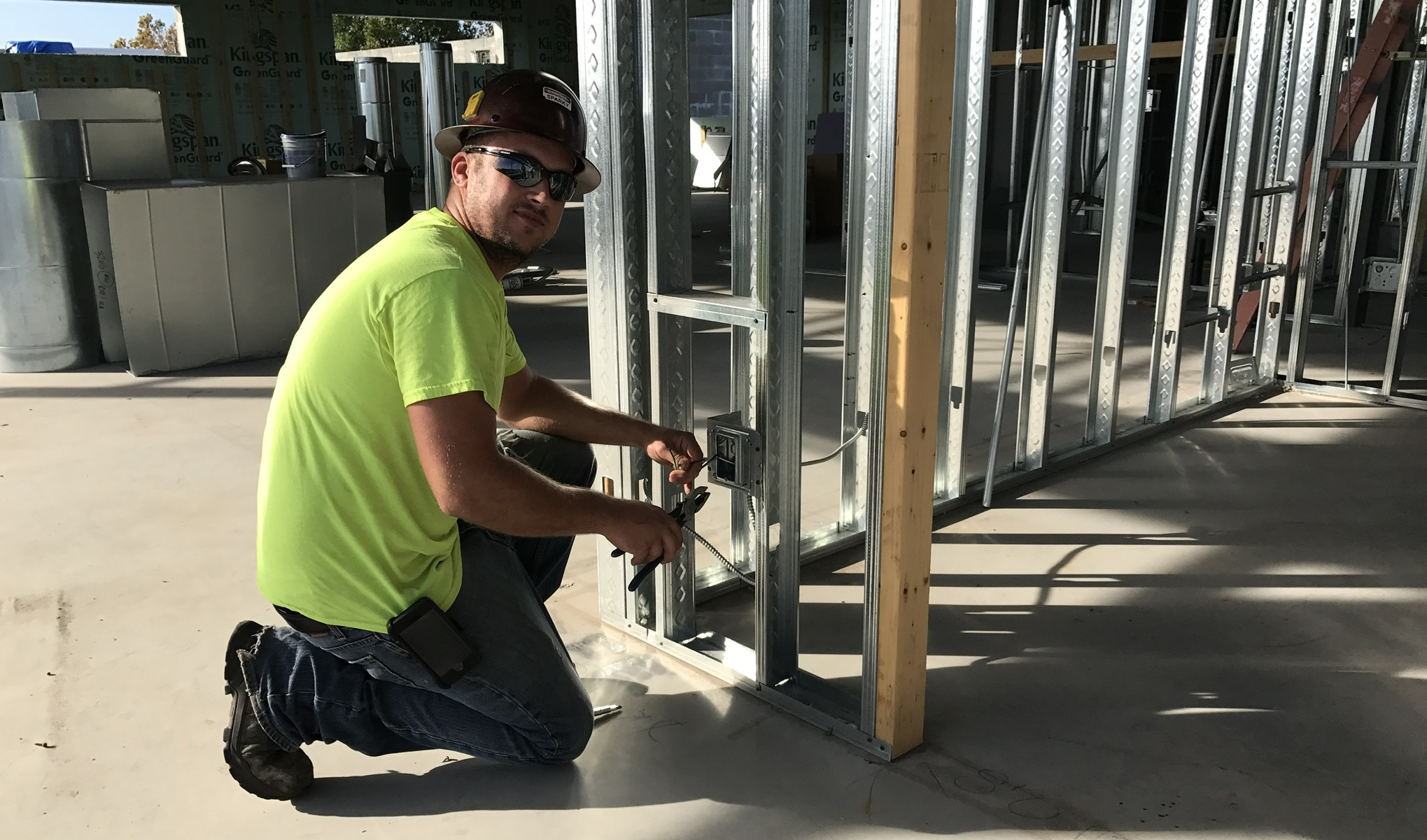 Electrician working on commercial rough