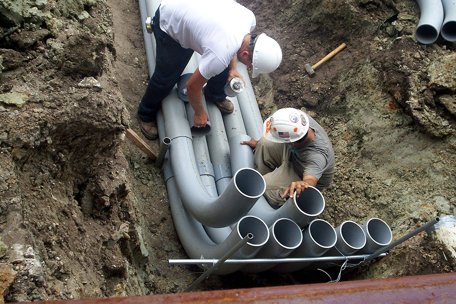Crew installing underground feeder conduits for a large church in Clearwater, FL.